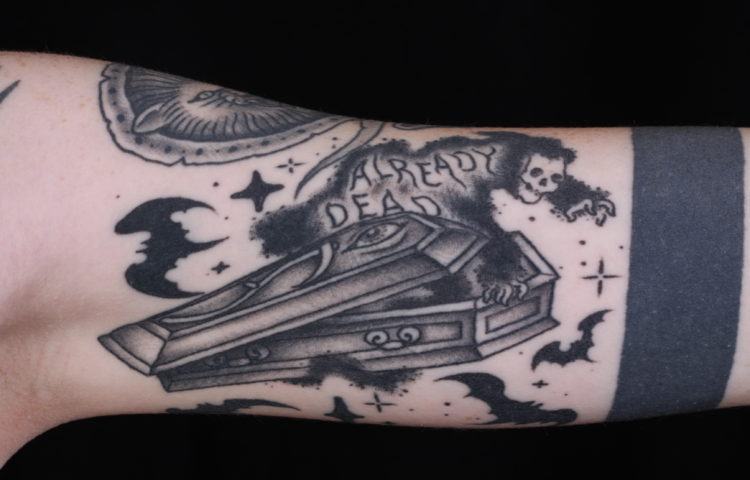 sam-yamini-dedication-tattoo-black-and-grey-coffin-reaper-text-bats-arm