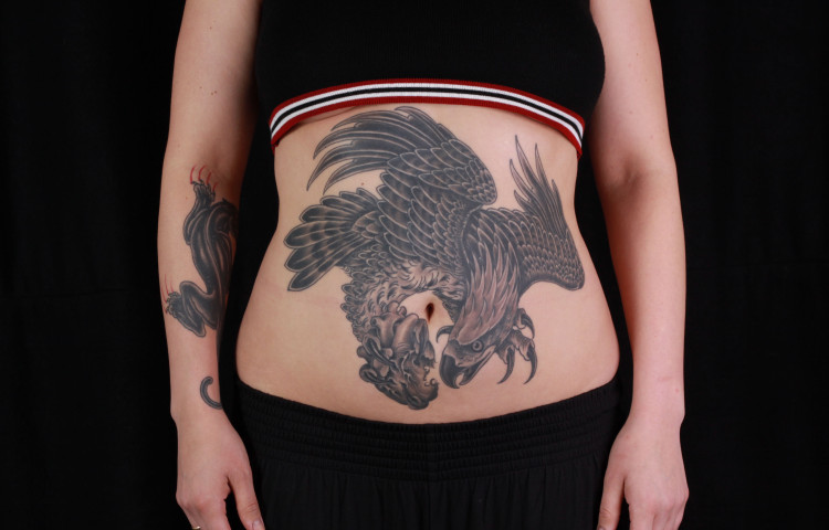 brian-thurow-dedication-tattoo-stomach-black-and-grey-eagle-anatomical-heart