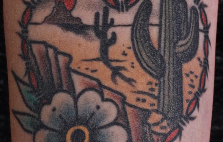 andy-canino-dedication-tattoo-traditional-cactus-desert-scene-heart-flower-arm
