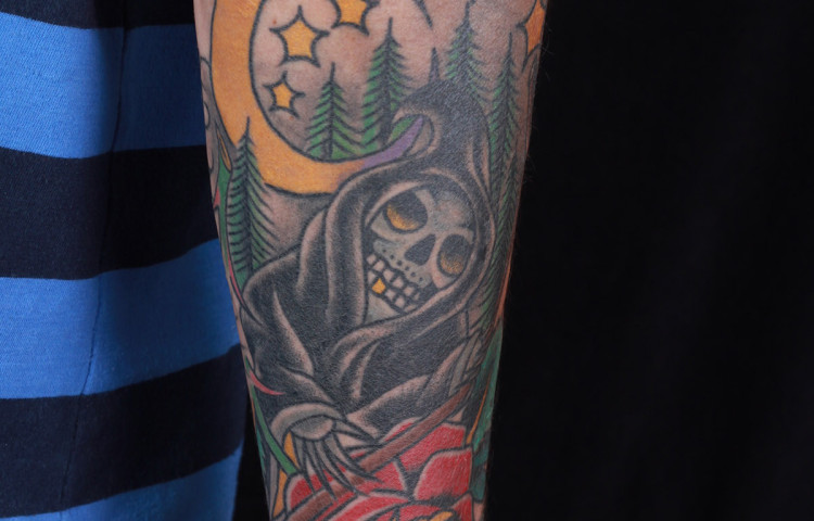 haley-mcmahon-dedication-tattoo-reaper-rose-moon-stars-scene-forearm-traditional