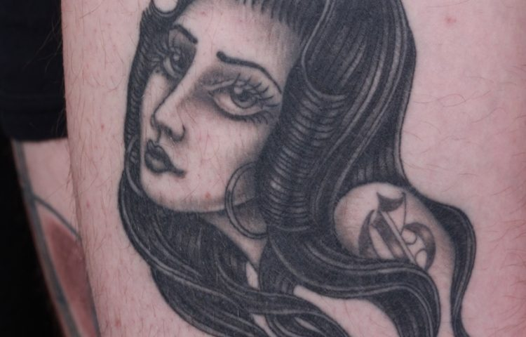 sam-yamini-dedication-tattoo-thigh-black-and-grey-chola-girl