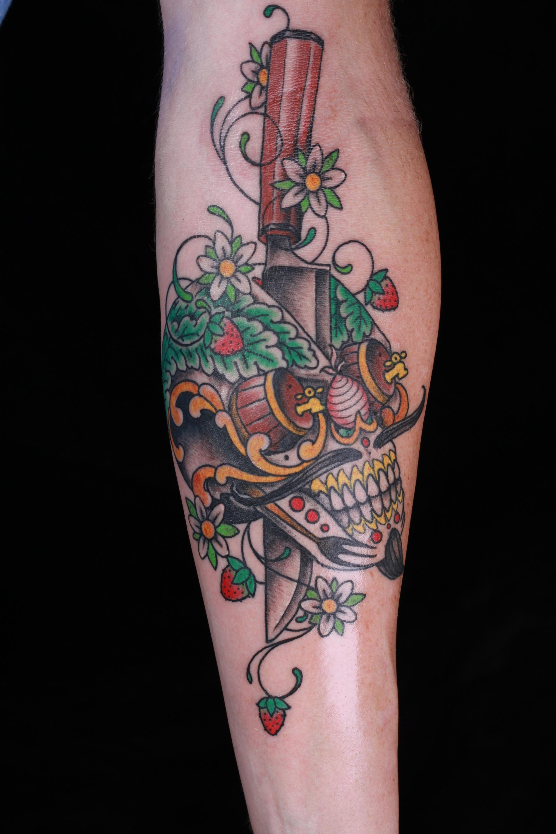 sam-yamini-dedication-tattoo-traditional-forearm-day-of-the-dead-skull-dagger-fruit-flowers