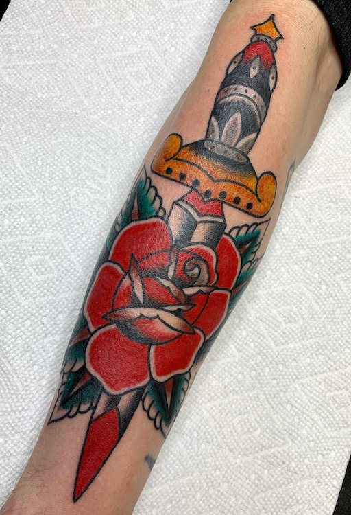 Traditional Rose and Dagger on Forearm By Alec Rowe